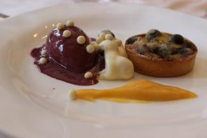 Blueberry clafoutis with apricot coulis and blueberry gelato prepared by Chef David Bouley