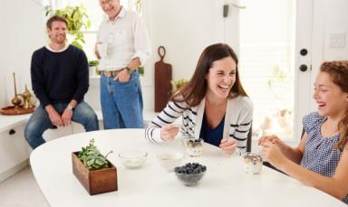 Family enjoying blueberries at breakfast